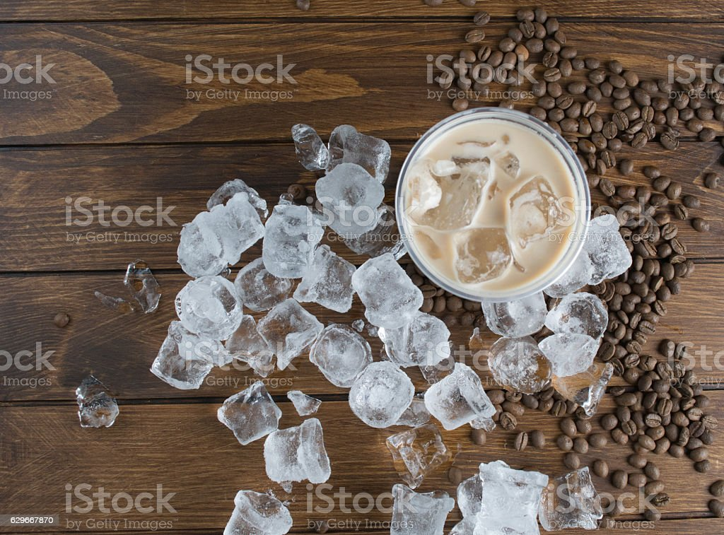 Ice coffee on wooden background stock photo