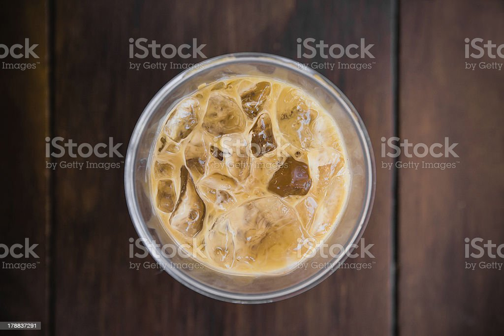 Ice coffee top view on wood background stock photo