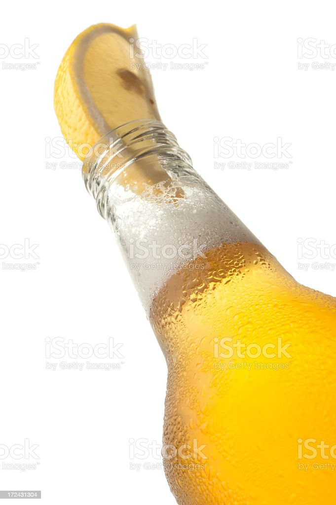 Ice cold beer bottle with lemon royalty-free stock photo