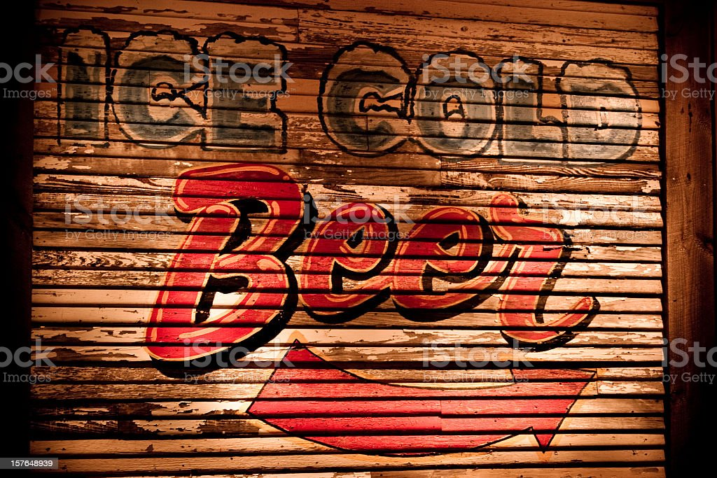 Ice Cold Beer sign on wooded side of building. Bar. royalty-free stock photo
