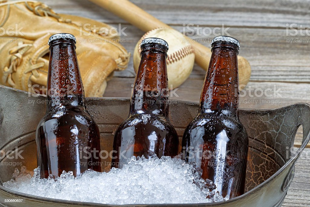 Ice Cold Bottle Beer and Baseball Stuff stock photo
