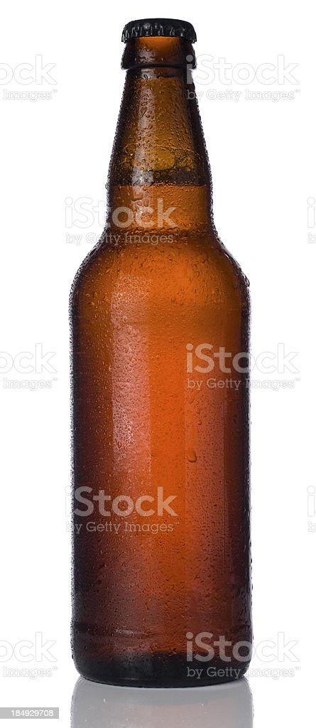 Ice cold bottle of beer isolated on a white background stock photo