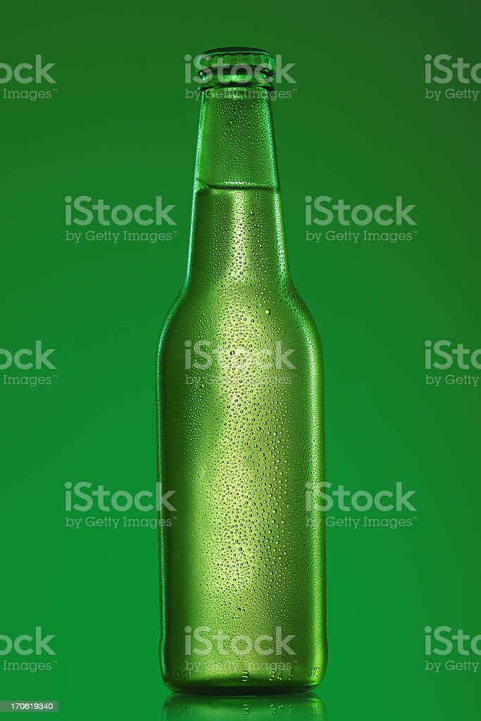 Ice cold bottle of beer stock photo