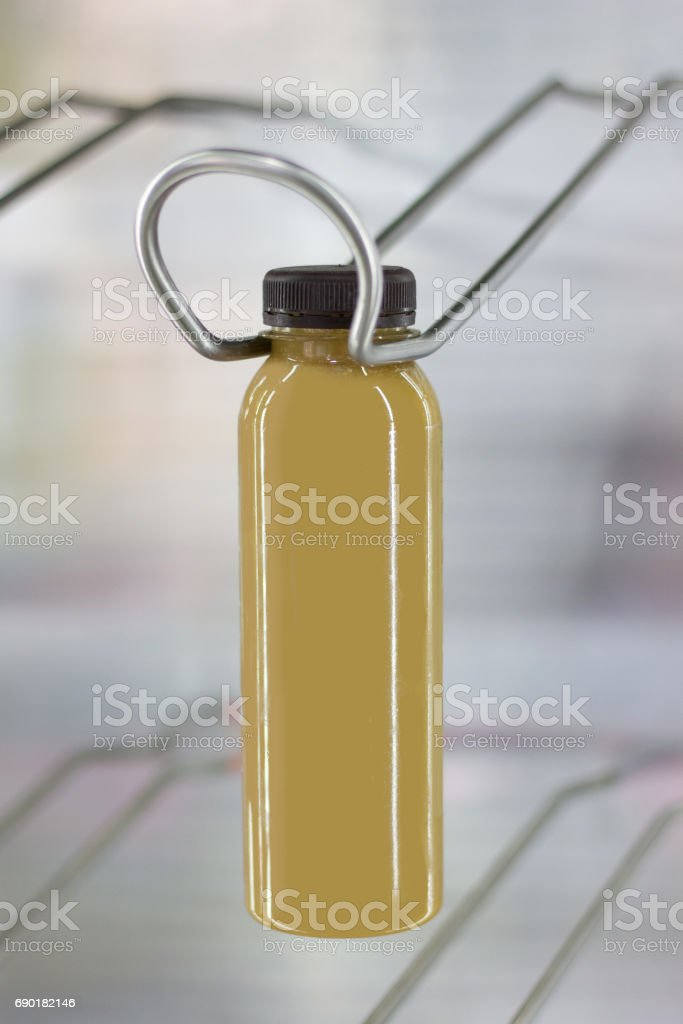 Ice cold coffee in bottle with black cap in refrigerator stock photo