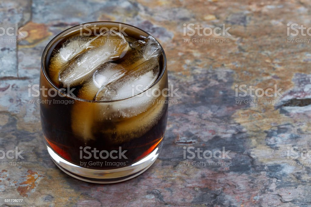Ice Cold Cola on Natural Slate Stone Setting stock photo