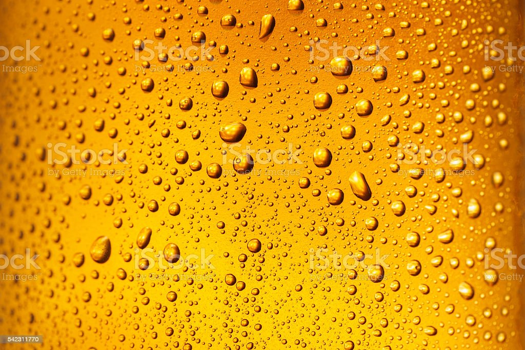Ice Cold  Glass Covered with water drops  condensation Beer Background stock photo