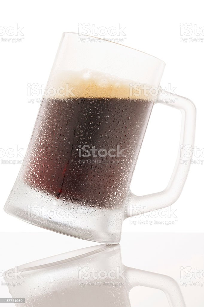 Ice Cold  Glass Dark Beer  Covered with water drops  condensation stock photo