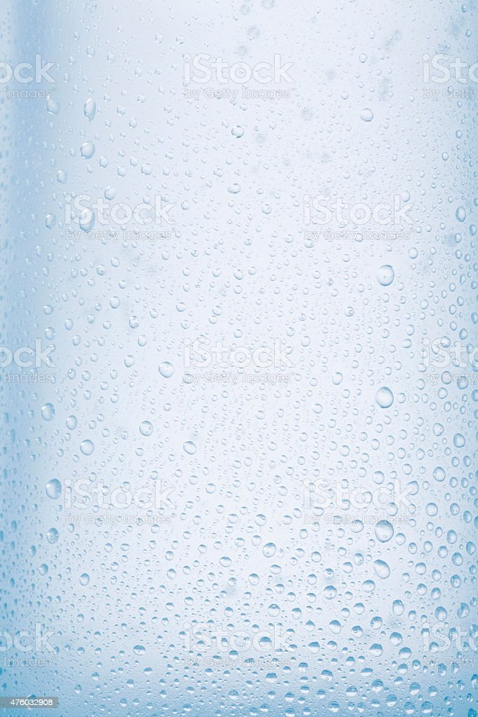 Ice cold  glass  Fresh water   Covered with water drops  condensation stock photo