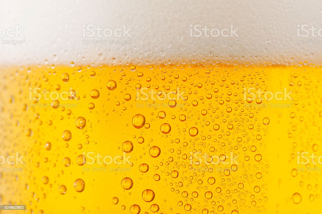 Ice Cold  Glass of Beer Covered with water drops  condensation stock photo