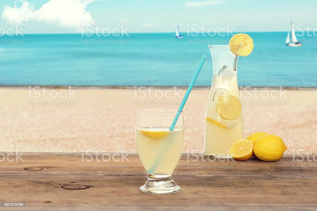ice cold lemonade at the beach stock photo