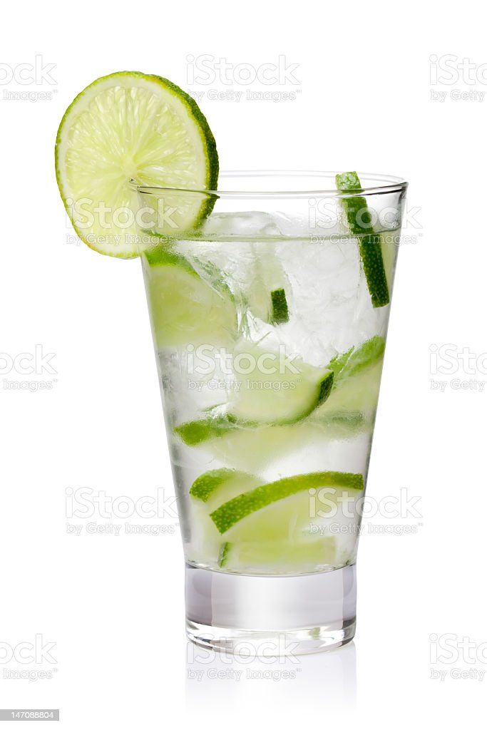 Ice cold lemonade with fresh lime slices isolated on white stock photo