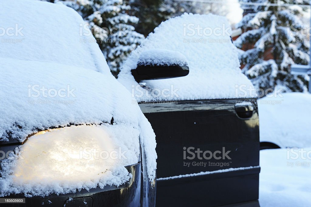 Ice cold weather, car covered by snow. stock photo