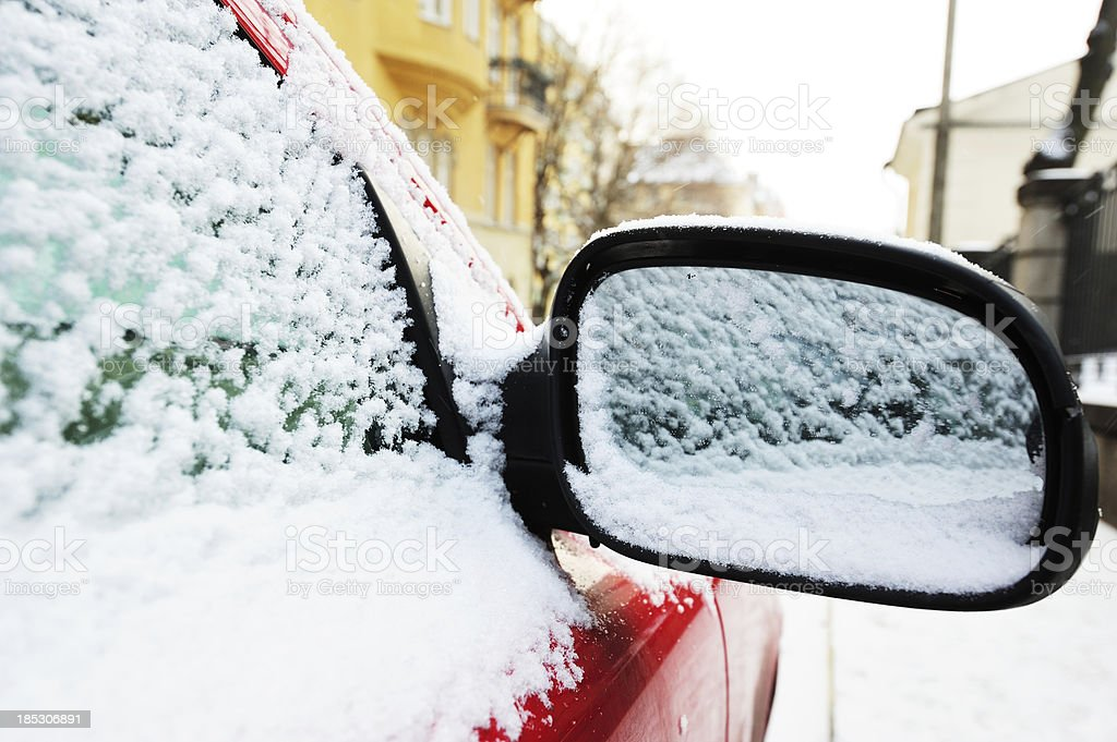'Ice cold weather, car mirror covered by snow.' stock photo