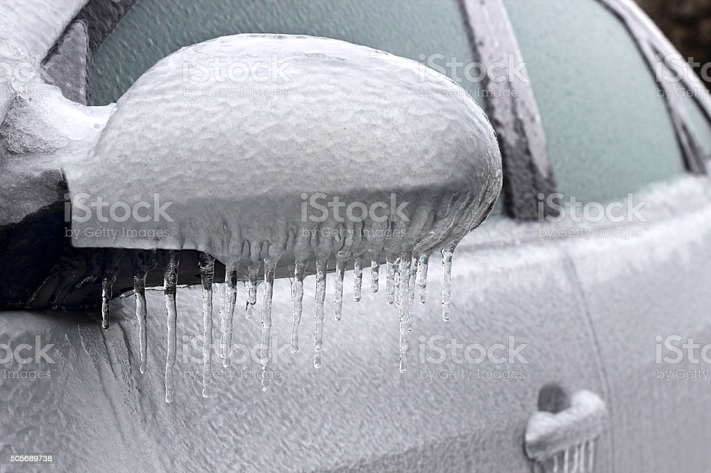 Ice covered car stock photo