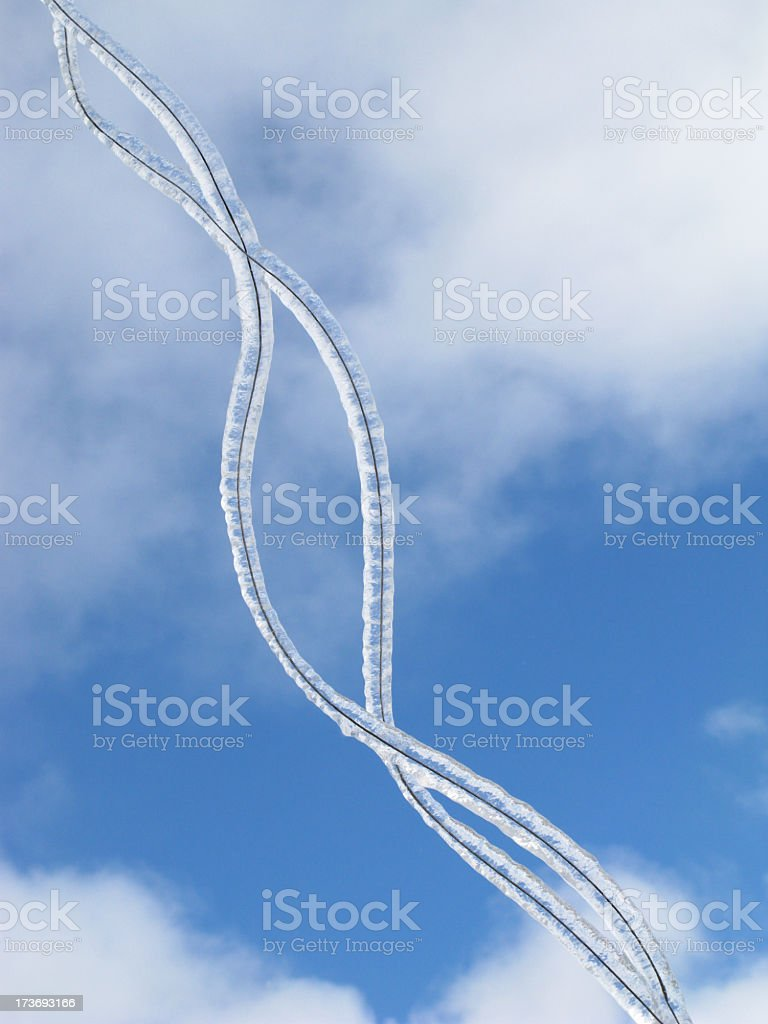 Ice covered wire and sky. royalty-free stock photo
