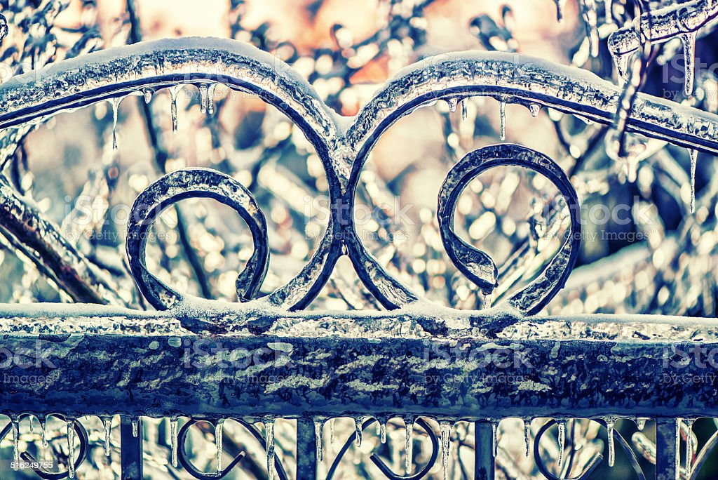 Ice Covered Wrought Iron Gate - Retro stock photo