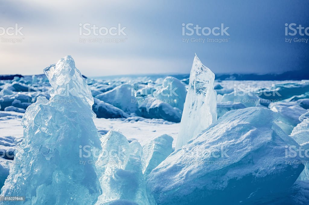 Ice cracks on Baikal surface stock photo