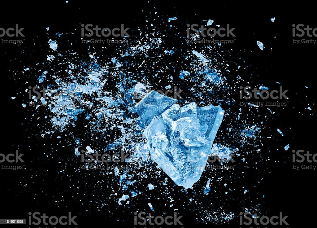 Ice crash explosion parts on black background stock photo