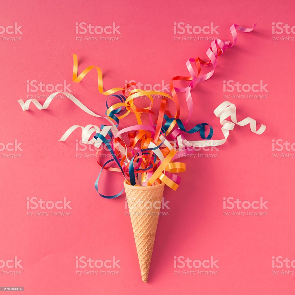 Ice cream cone with party streamers stock photo