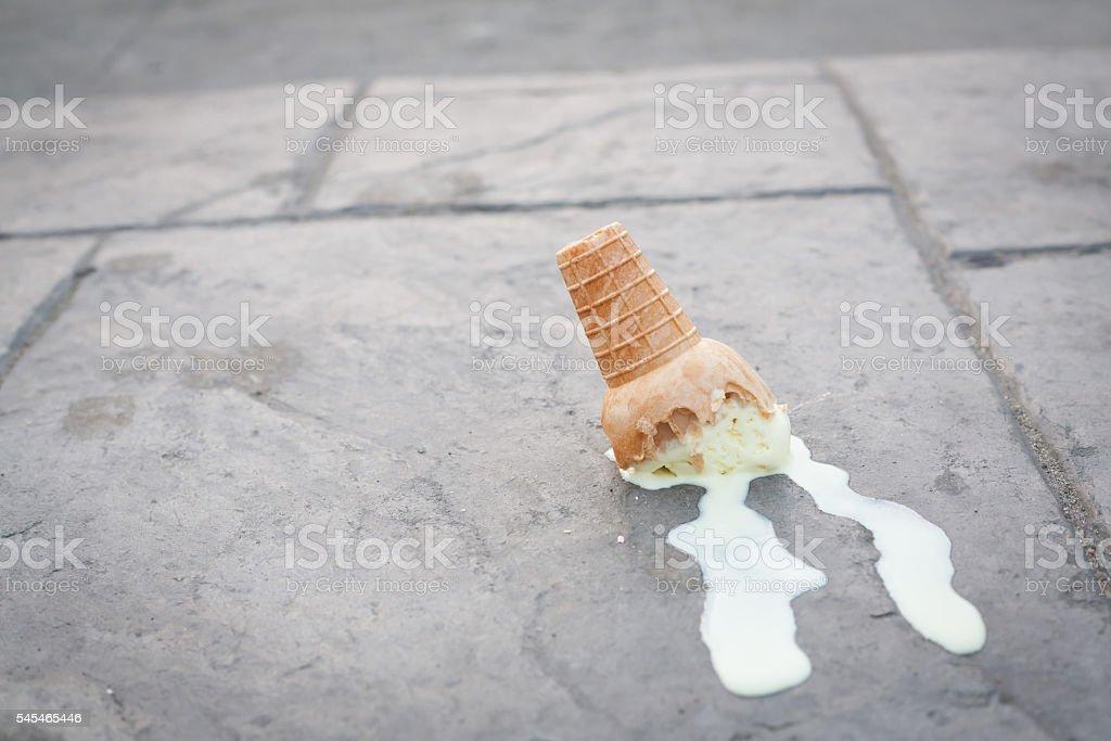 Ice cream on the ground. (selective focus) stock photo