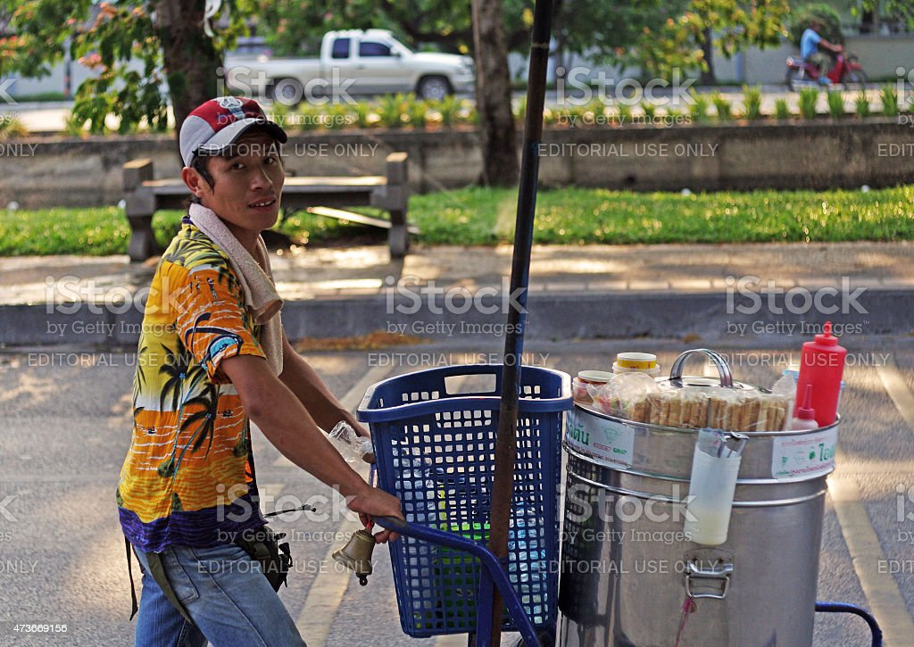 Thai ice cream seller with ice cream cart stock photo