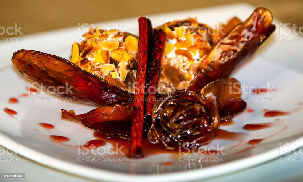 Ice cream with almonds and caramel stock photo