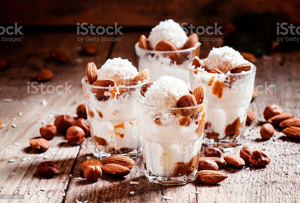 Ice cream with peanut sauce, hazelnuts and almonds stock photo