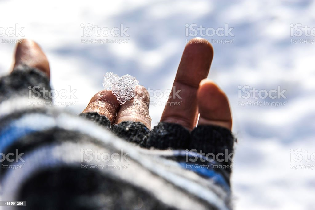 Ice crystal on the finger stock photo