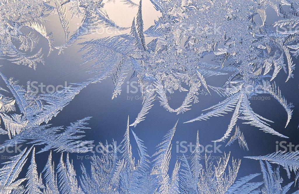 Ice crystals on window glass stock photo