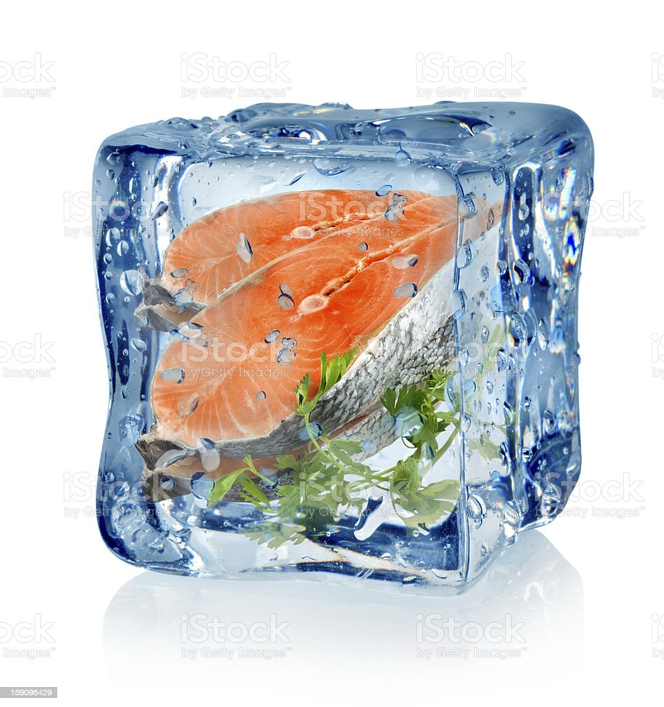 Ice cube and fish with parsley stock photo