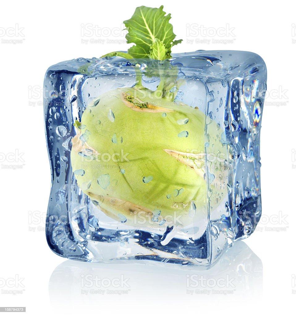 Ice cube and kohlrabi royalty-free stock photo