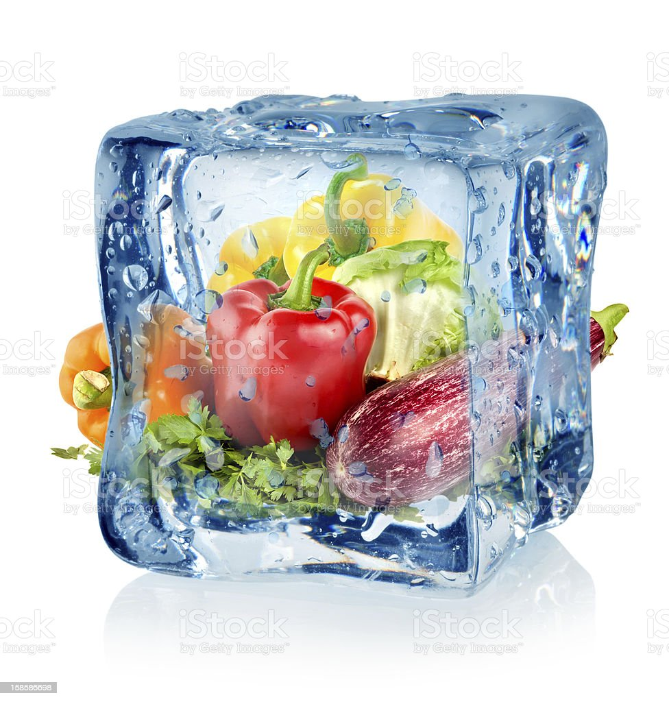 Ice cube and vegetables stock photo