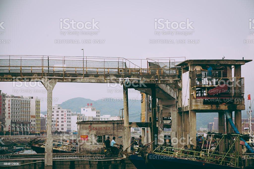 Ice cube conveyor equipment in China fishing port stock photo
