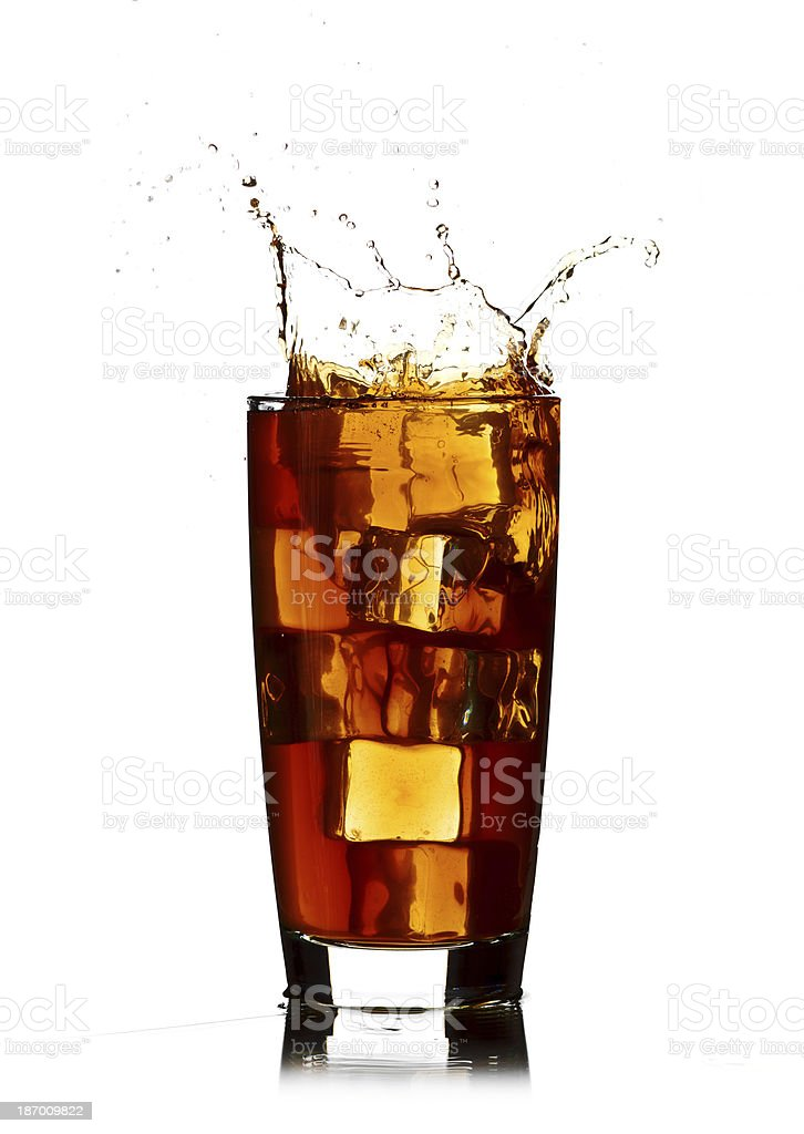 Ice cube droped in cola glass isolated on white background royalty-free stock photo