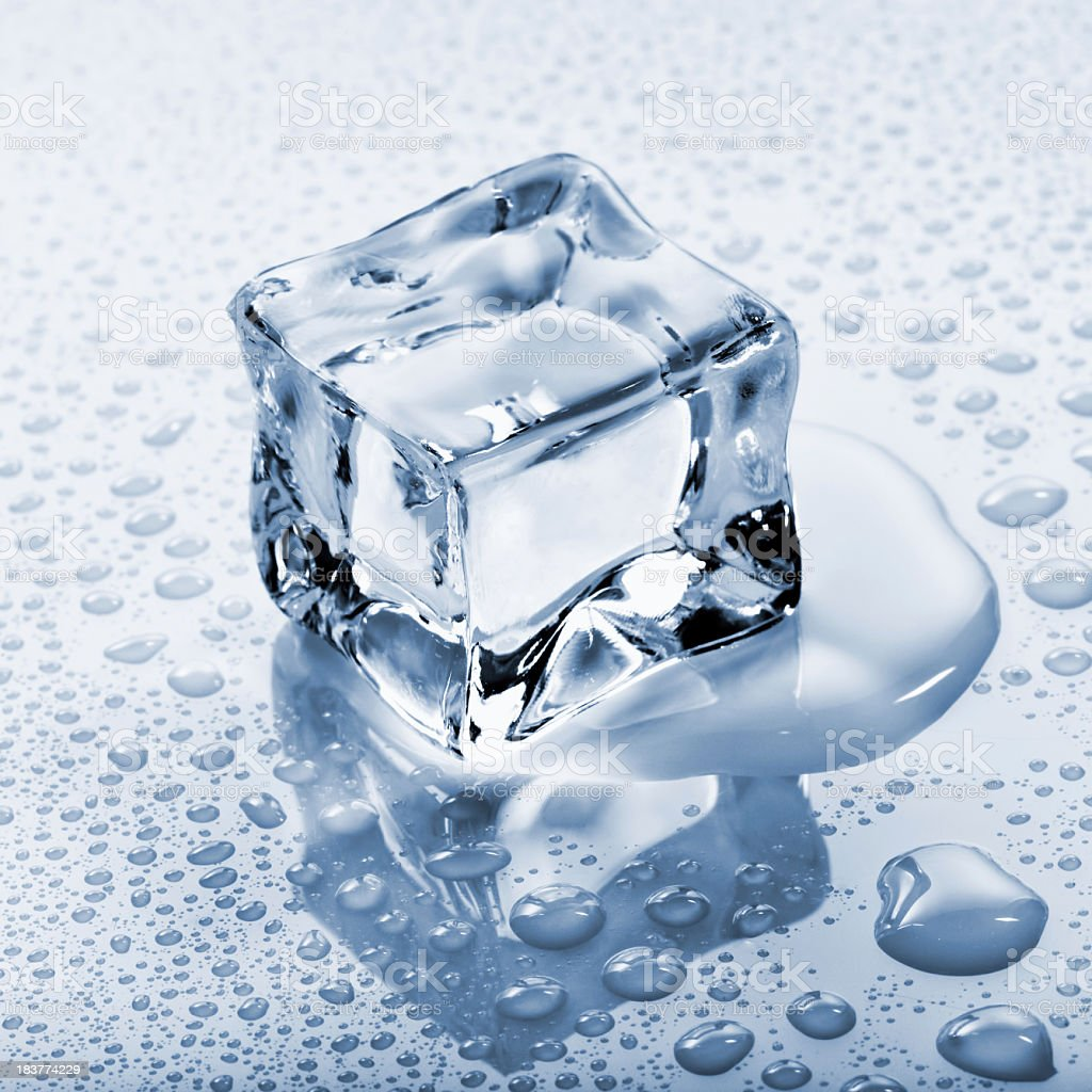 Ice Cube on background with water droplets royalty-free stock photo