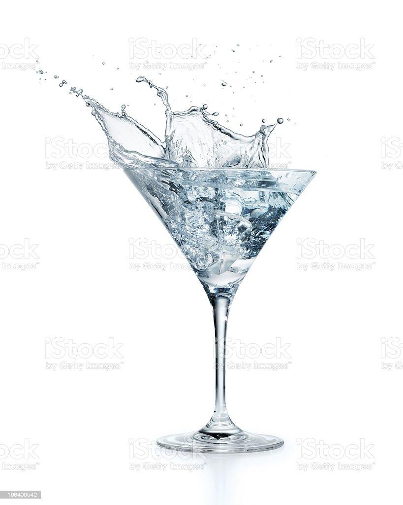 Ice cube splashing in Martini royalty-free stock photo