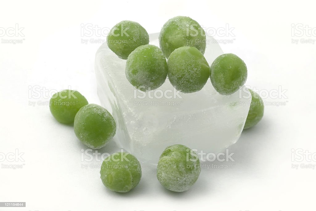Ice Cube with ten peas royalty-free stock photo