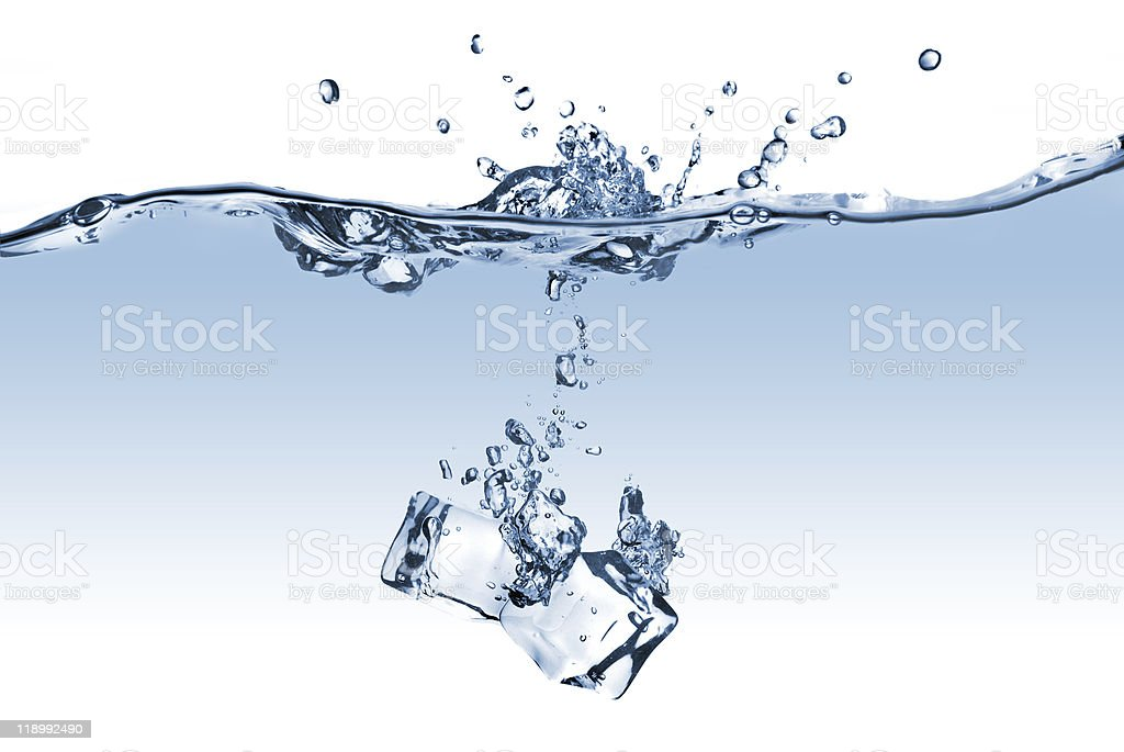 ice cubes dropped into water isolated on white stock photo