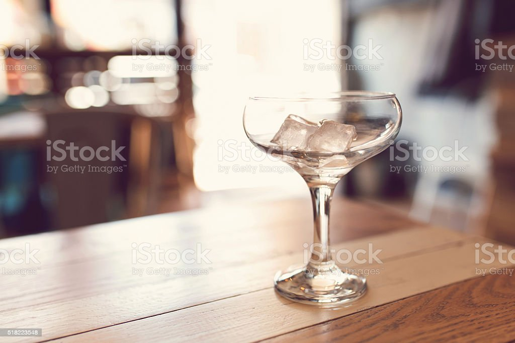 Ice Cubes In A Coupette Glass stock photo
