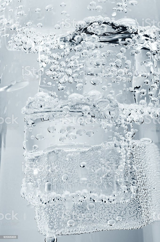 Ice cubes in a glass of mineral water royalty-free stock photo