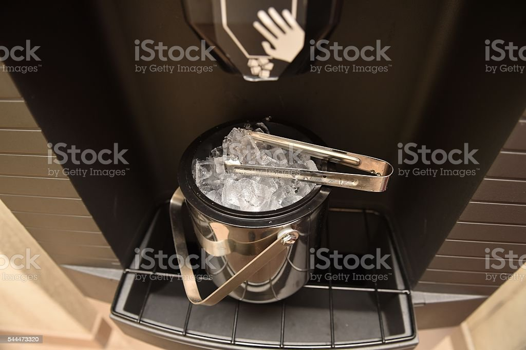 Ice cubes maker stock photo