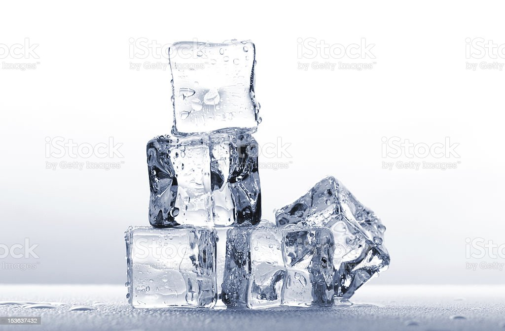 Ice cubes on wet background royalty-free stock photo