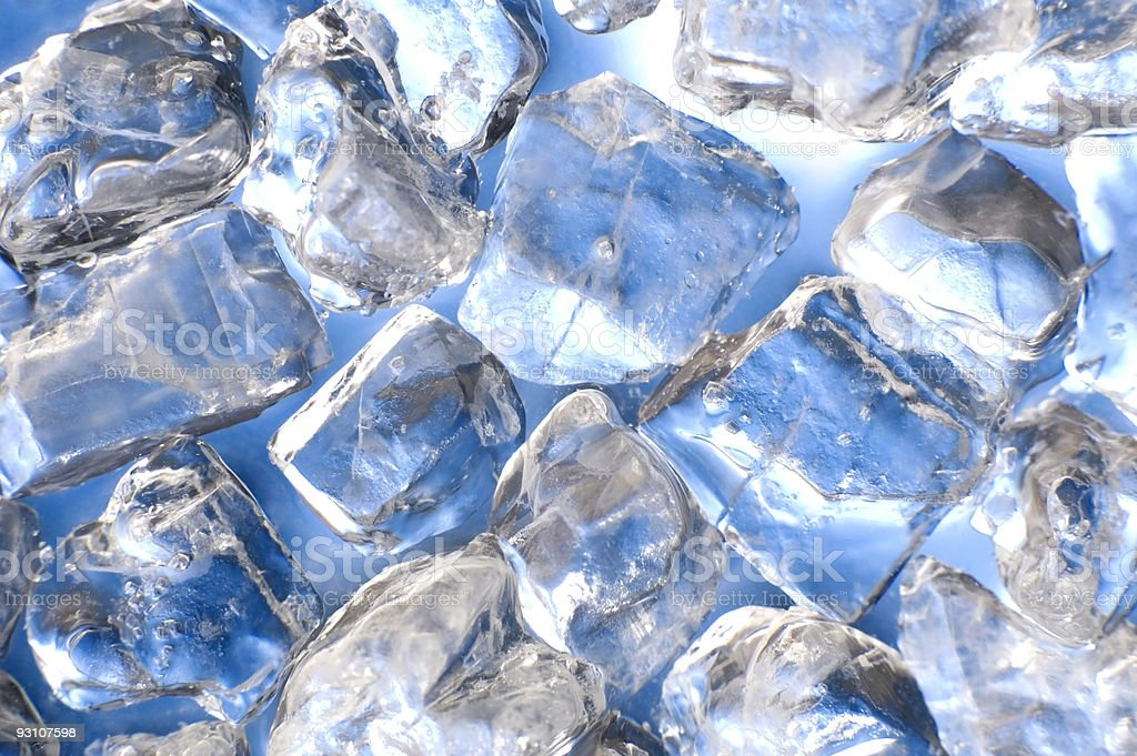 Ice cubes reflecting blue color royalty-free stock photo