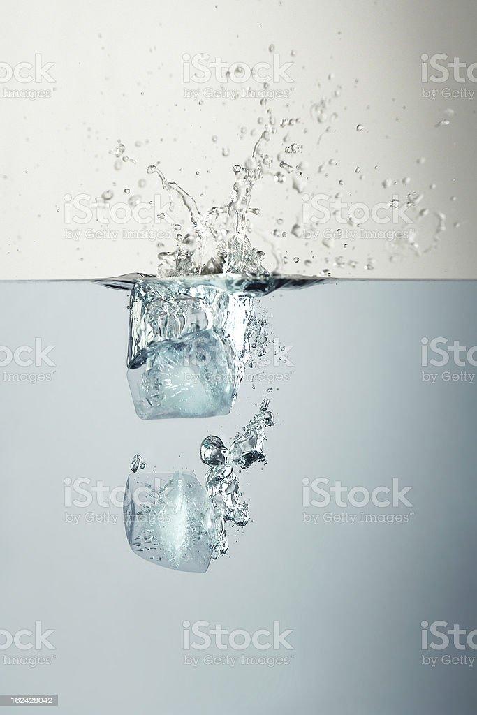 Ice cubes splash royalty-free stock photo