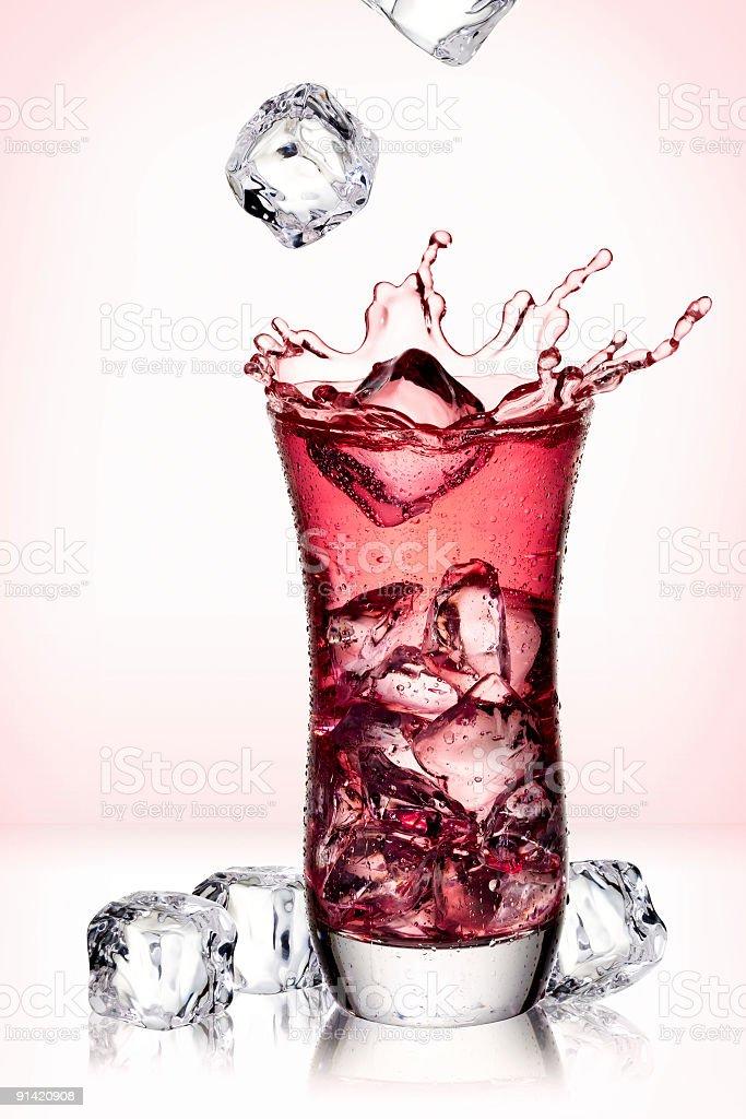 Ice Cubes Splashing into Juice royalty-free stock photo