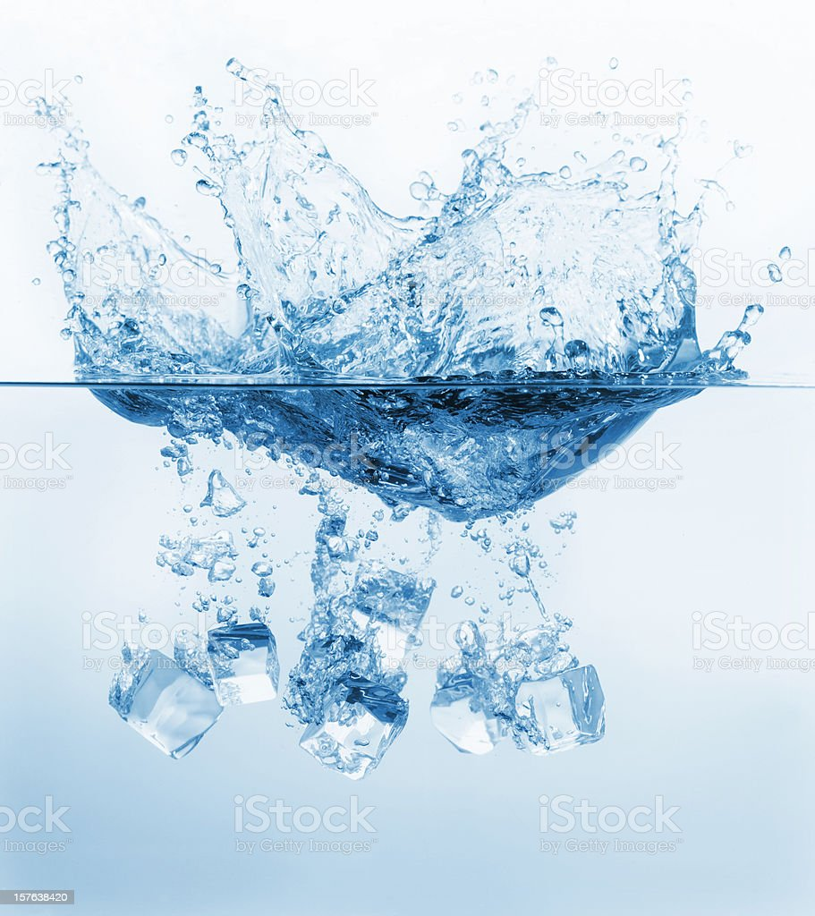 Ice cubes splashing into the water royalty-free stock photo