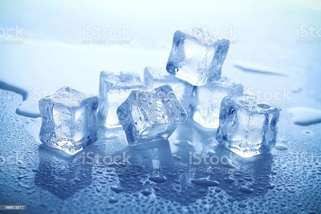 Ice cubes with water beneath them royalty-free stock photo