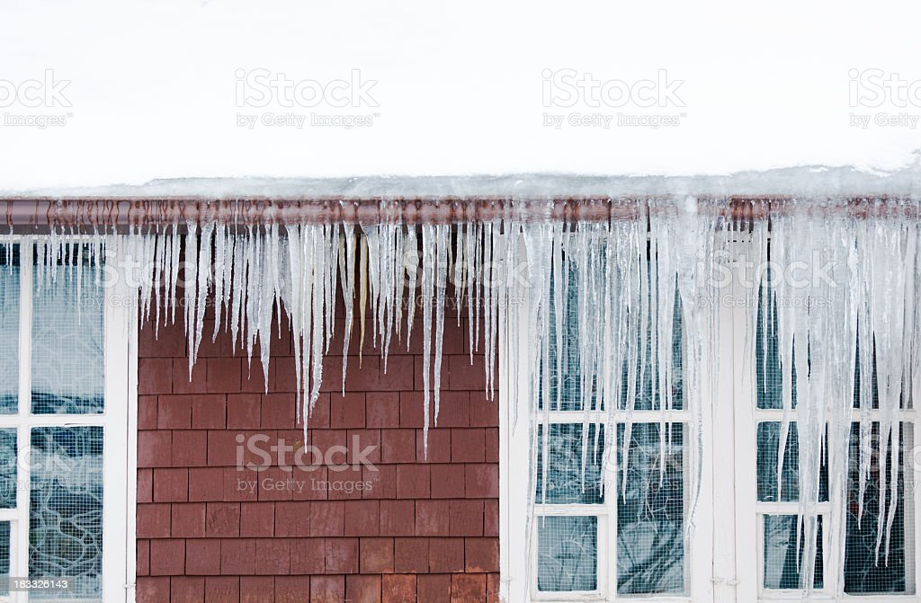 Ice Dams, Snow on Roof, Icicles Causing Winter House Damage stock photo