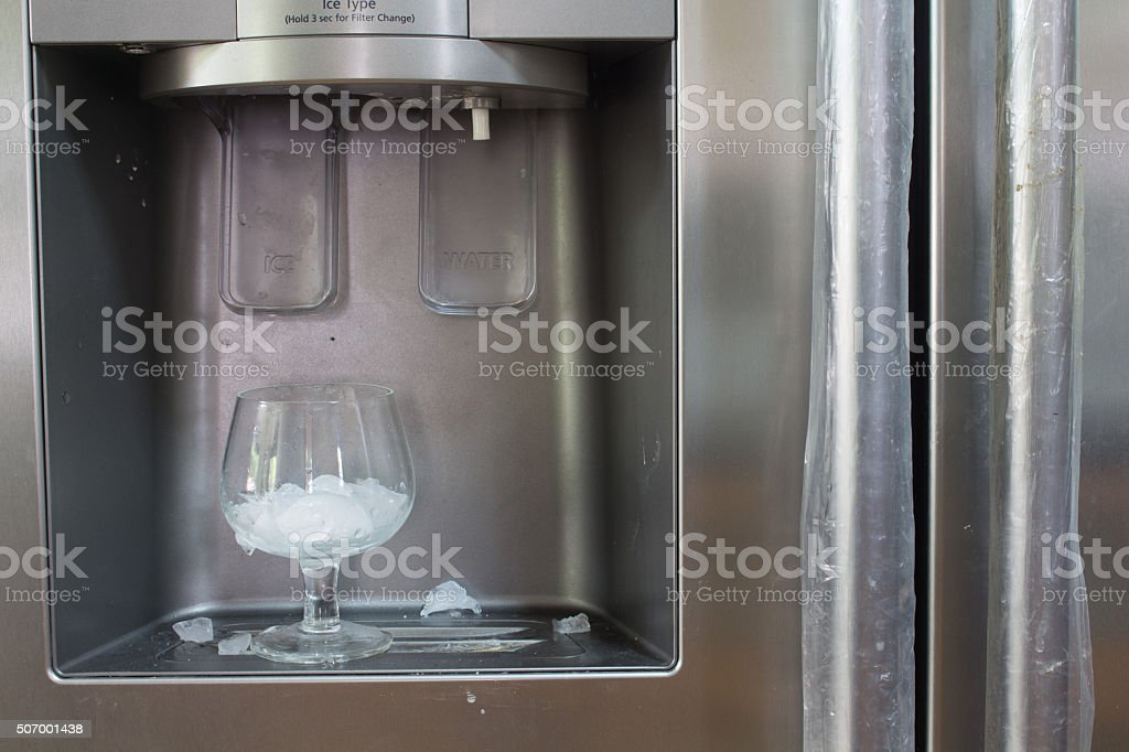 Ice dispenser and glass stock photo
