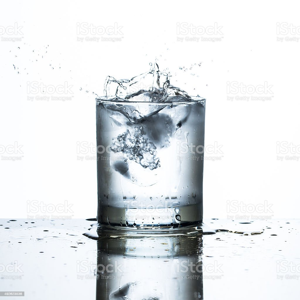 ice drop on glass of water stock photo